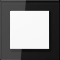 Jung Acreation biały włącznik w czarnej szklanej ramce. Pojedynczy uniwersalny.