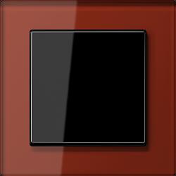 Jung Acreation czarny włącznik w czerwonej szklanej ramce. Pojedynczy uniwersalny.